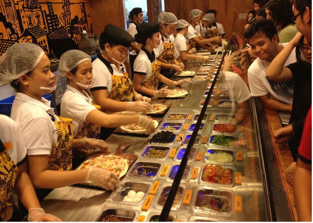 Pizza Republic Cebu Pick + Mix counter features rows of toppings.